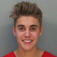 justin-bieber-mugshot-dui-drag-racing-arrested-handbag.jpg